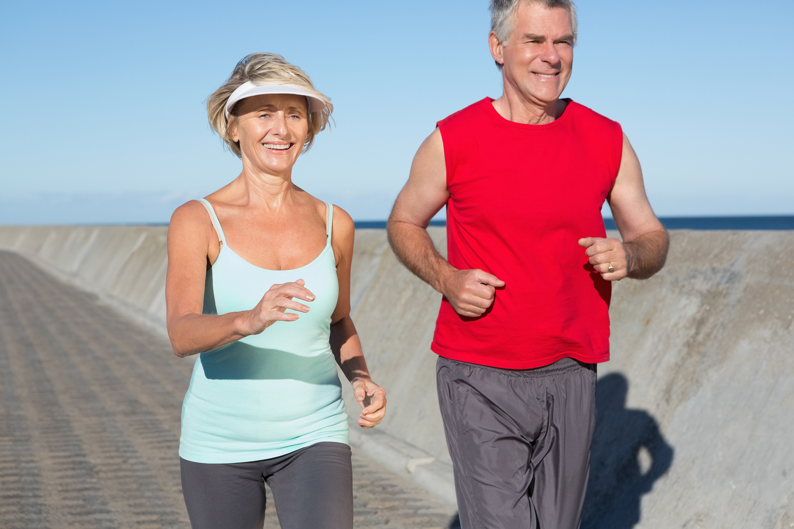 Bigstock-78219566-Active-senior-couple-out-for-a-jog-on-a-sunny-day1
