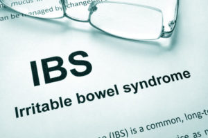 60526867 - paper with words irritable bowel syndrome (ibs) and glasses.