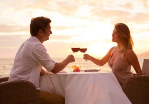28878070 - couple sharing romantic sunset dinner on the beach